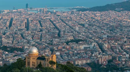 europe population : Panorama of Barcelona timelapse from Mount Tibidabo. Catalonia, Spain.