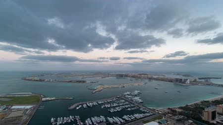 manmade : Jumeirah Palm Island night to day timelapse dubai shot from the rooftop top of the tower in dubai marina, uae Stock Footage