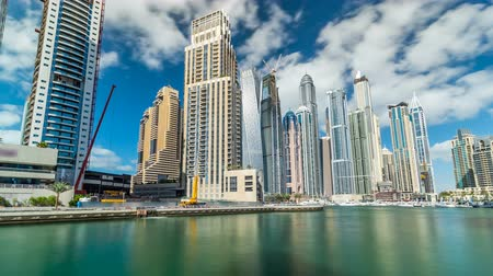 Объединенные Арабские Эмираты : View of Dubai Marina Towers and canal in Dubai timelapse hyperlapse