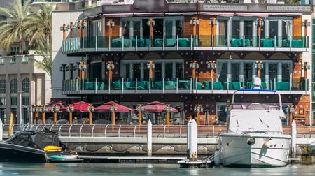 orta doğu : Promenade and restaurants timelapse at the Marina walk, During day time. Dubai, UAE