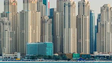 vnitrozemí : Jumeirah Beach Residence as seen from the palm jumeirah with sea timelapse. Dubai, United Arab Emirates