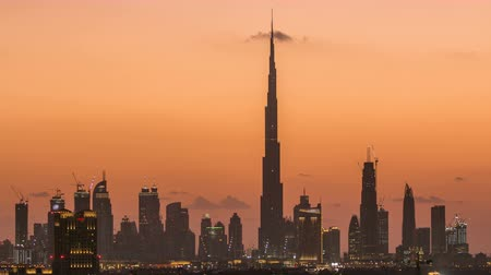 birleşik arap emirlikleri : Skyline of Downtown Dubai day to night timelapse. Stok Video