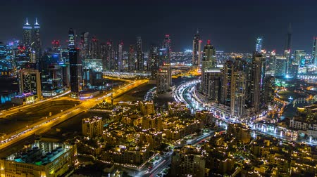 východní : Scenic aerial view of a big modern city at night timelapse. Business bay, Dubai, United Arab Emirates.