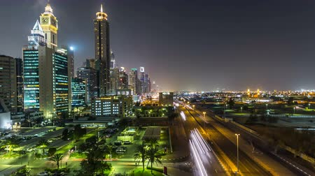 tetőtéri : Downtown Dubai towers night timelapse. Aerial view of Sheikh Zayed road with skyscrapers.