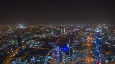 skyscraper : Skyline with Skyscrapers night timelapse in Kuwait City downtown illuminated at dusk. Kuwait City, Middle East Stock Footage