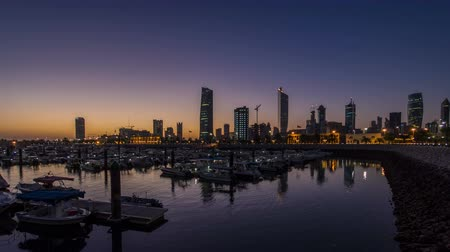 východní : Yachts and boats at the Sharq Marina night to day timelapse in Kuwait. Kuwait City, Middle East