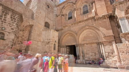 sepulcher : Vew on main entrance in at the Church of the Holy Sepulchre in Old City of Jerusalem timelapse hyperlapse Stock Footage