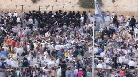 tallit : Religious Jews sunset prayer service at the Western Wall, Israel timelapse Stock Footage