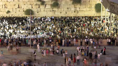 sukkot : Religious Jews sunset prayer service at the Western Wall, Israel timelapse Stock Footage