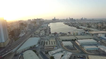 east pearl : Cityscape of Ajman with modern buildings aerial top view
