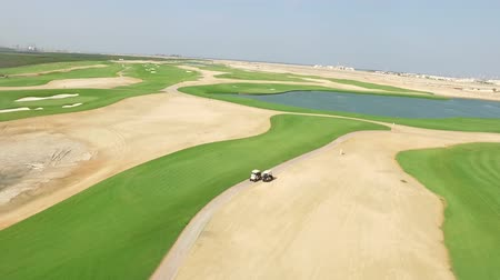 arabian sea : Cityscape of Ajman with golf fields aerial top view