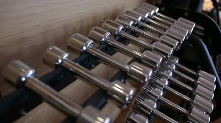 kilogramm : Set of metal dumbbell lying in a row on the stand horizontally
