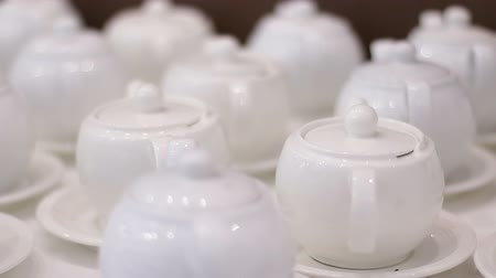 bica : White teapots on a table