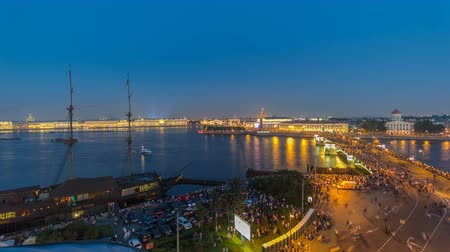 ermita : Night view of spit of Vasilyevsky Island and Birzhevoy Bridge with rostral column timelapse, Saint Petersburg, Russia.
