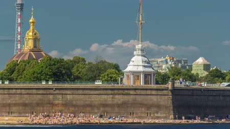 peter and paul fortress : Beach near Peter and Paul Fortress across the Neva river timelapse, St. Petersburg, Russia Stock Footage
