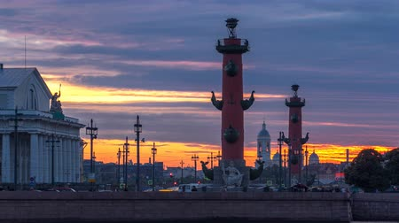 vasilevsky : Sunset over Strelka - Spit of Vasilyevsky Island with the Old Stock Exchange and Rostral Columns timelapse in Saint Petersburg, Russia