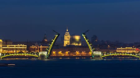 st petersburg : Night view of spit of opened Birzhevoy Bridge timelapse, Saint Petersburg, Russia.