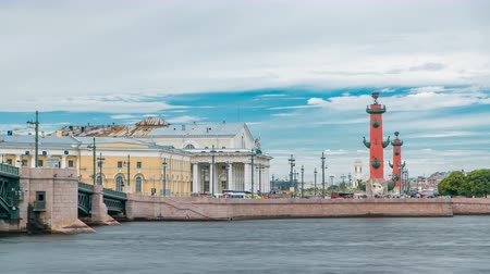 vasilevsky : Strelka - Spit of Vasilyevsky Island with the Old Stock Exchange and Rostral Columns timelapse in Saint Petersburg, Russia Stock Footage