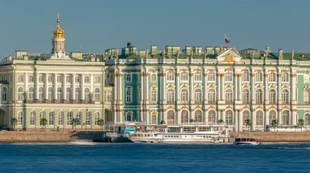 winter palace : Tourists in the excursion boat sail on The Neva River timelapse. On the back side is The State Hermitage Building Winter Palace