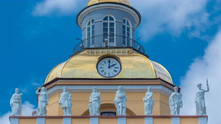 pozlacený : Upper part with clock of the tower of the Admiralty building timelapse in St. Petersburg, Russia. Dostupné videozáznamy