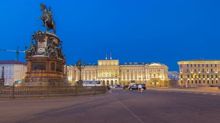 alexander column : View of the Mariinsky palace and monument to Nikolay I from Isaacs square day to night timelapse hyperlapse. Saint-Petersburg, Russia Stock Footage