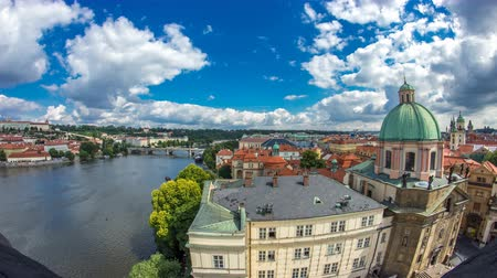 helyettes : view of the manes bridge with a building of the czech parliament behind it timelapse from Old Town Bridge Tower. Stock mozgókép