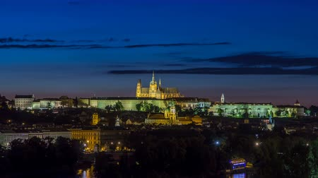 hradcany : Evening view of Prague Castle over Vltava river timelapse, Czech Republic