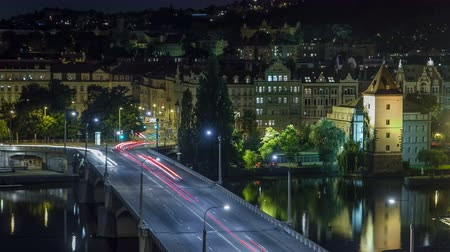 cseh : Jirasek Bridge on the Vltava river night timelapse in Prague, Czech Republic