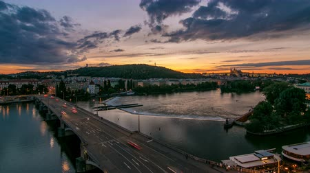 hradcany : The View on Prague Hill Petrin timelapse with Owls Mills day to night with beautiful colorful sky, Czech Republic