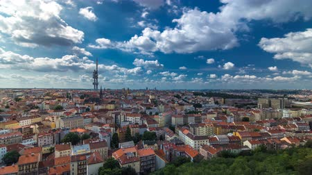 tv tower : Timelapse view from the top of the Vitkov Memorial on the Prague landscape on a sunny day with the famous Zizkov TV tower on the horizon