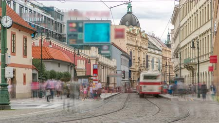 valoun : One of the symbol of Prague a tram - street car turning in Old Town Stare Mesto by Prague Namesti Republiky station timelapse. Prague, Czech Republic