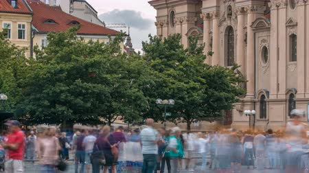 Československo : The Church of St. Nicholas behind the trees timelapse in Prague, Czech Republic