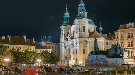 art : Baroque St. Nicholas Cathedral on the Oldtown Square in Prague with monument Jan Hus illuminated at night timelapse
