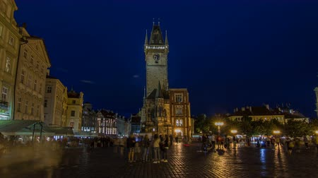 cheque : Prague Old Town Hall at Night timelapse hyperlapse with unrecognizable tourists walking
