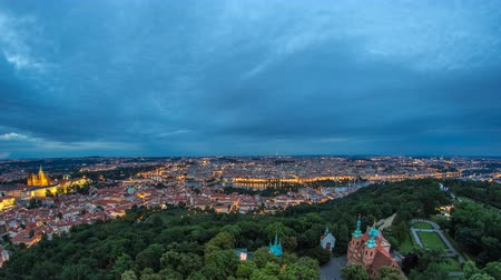 csehország : Wonderful day to night timelapse View To The City Of Prague From Petrin Observation Tower In Czech Republic Stock mozgókép