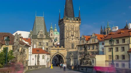 lesser : A view along Charles Bridge in Prague towards the Lesser Quarter in the morning timelapse.