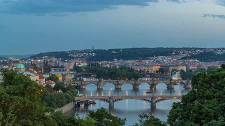 mala : Scenic view of bridges on the Vltava river day to night timelapse and of the historical center of Prague: buildings Vídeos