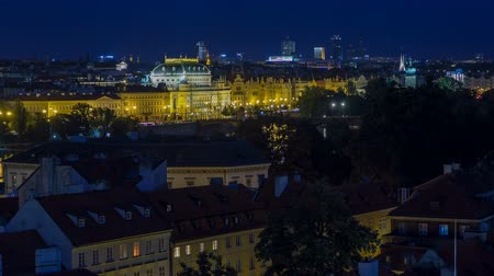hradcany : Illuminated National Theatre in Prague at night with reflection in Vltava River timelapse, Czech Republic