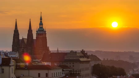 hradcany : A beautiful view of Prague at sunrise on a misty morning timelapse. Stock Footage