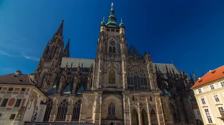 hradcany : St. Vitus Cathedral timelapse hyperlapse in Prague surrounded by tourists.