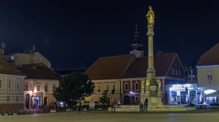 turistik : Holy Mary monument in front of the Cathedral night timelapse in Zagreb, Croatia