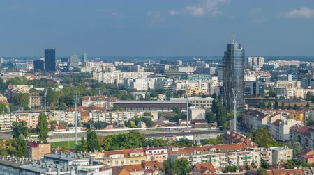 telha : Panorama of the city center timelapse of Zagreb, Croatia, with modern and historic buildings, museums in the distance.