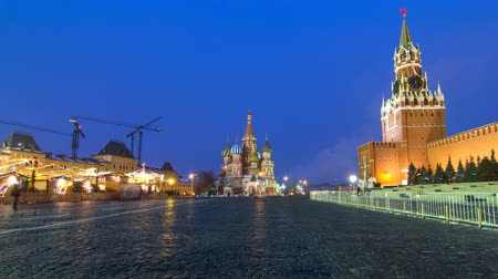 lenin : Red Square in winter day to night timelapse. Moscow Kremlin with Spasskaya tower and Cathedral of St. Basil, Russia