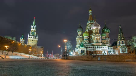 lenin : Moscow Kremlin timelapse hyperlapse with Spasskaya tower and Cathedral of St. Basil, Russia. Red Square in winter night
