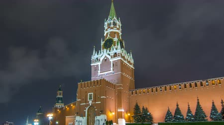 chime : View of The Saviour Spasskaya Tower timelapse hyperlapse and Kremlin walls of Moscow Kremlin, Russia at night in winter. Stock Footage