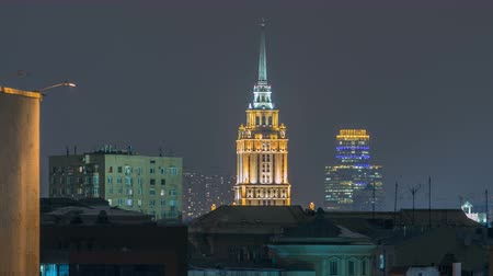 лед : Hotel Ukraine with roofs timelapse, landmark near historic center of Moscow. Cityscape in snowy winter evening.