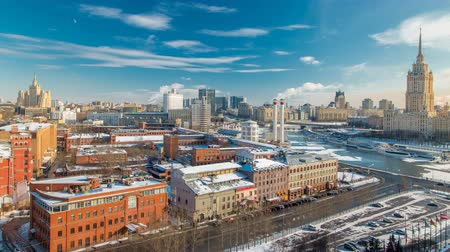 citylandscape : Top view on a winter city Moscow timelapse. Urban landscape with a frozen river