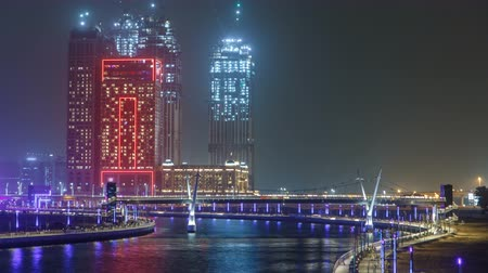 lavish : The new Dubai Water Canal with view on the city skyline timelapse, United Arab Emirates