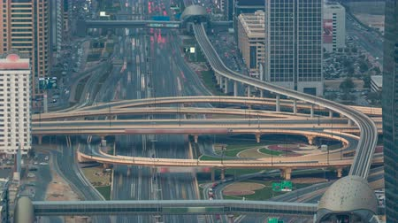 cityskyline : Aerial view of highway junction with traffic timelapse in Dubai, UAE, at sunset. Famous Sheikh Zayed road in Dubai downtown.