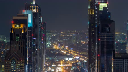 yoğunluk : Dubai Sheikh Zayed Road night timelapse near Dubai Downtown Closer Look shows the density of these roads Stok Video